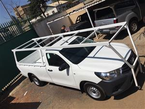Contractors pick up roof racks installed