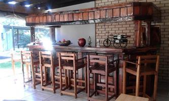 Sleeper wood bar with 6 chairs.930