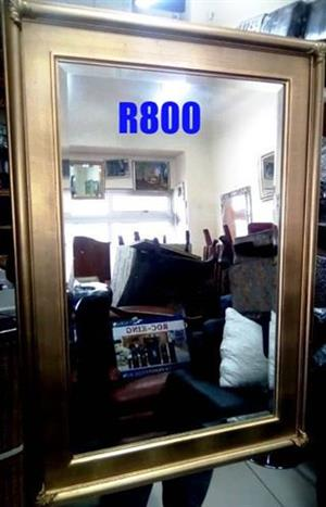 Wooden frame mirror for sale.