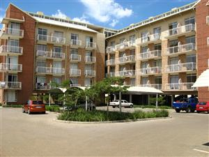 Charming semi-furnished bachelors flat with balcony and one carport up for rent.