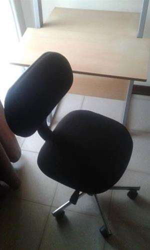 Black typist chair with wheels