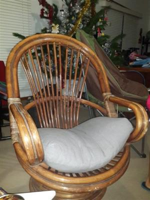 Bamboo and rattan strapping swivel and rocking high back chair