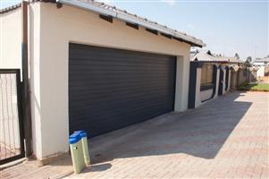 Single and double aluzinc sectional doors in Fourways