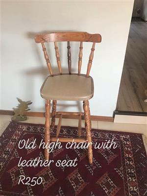 Old high chair with leather seat