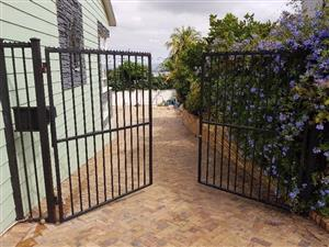 Large steel driveway gates - double swing with auto operators