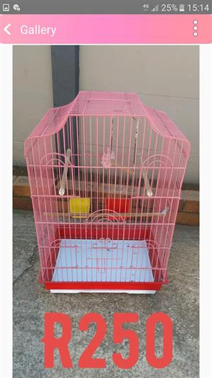 Pink and red parrot cage