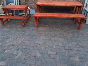 Big and small wooden garden benches