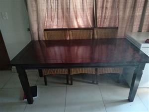 Mahogany dining room table and 6 chairs.