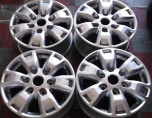 FORD 16 inch Mag Rims {Set of 4}. With Central Cabs for R4000.