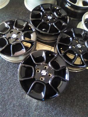 15 inch Suzuki rims 4x100 pcd for R3000.