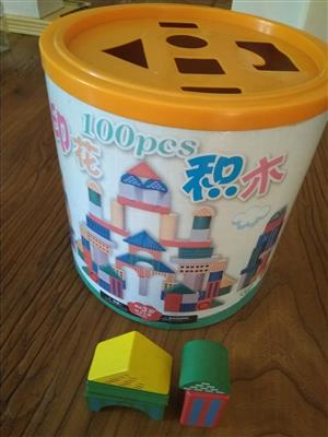 Large tub of wooden building blocks