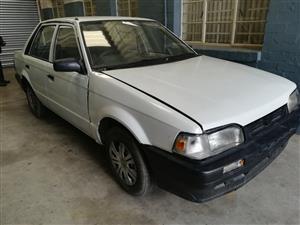 Mazda 323 1998 1300 Breaking for spares