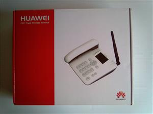 Huawei F317 Land line lookalike SIM Card enabled with own battery. In a box. As good as new.
