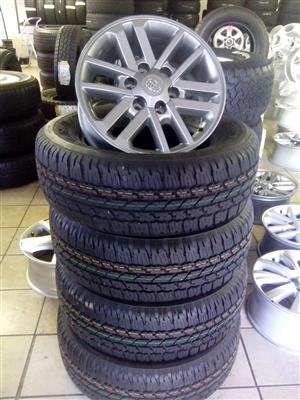 Darker twinspoke 17 inch rims with 265/65/17 Bridgestone Dueller brand new tyres x4 R11500 set.