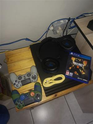PS4 Pro with Pro gaming headset For sale