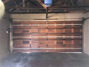 Double wooden garage door for sale!