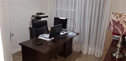 Office desk and chair, L-Shape: 3 Drawers and credenza. Like new. Dark finish with new office chair.