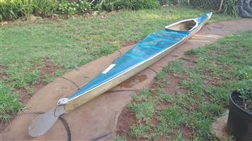Cyclone racing kayak and oar.