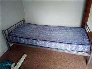 Grey framed single bed