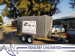 TRAILERS UNLIMITED CATTLE TRAILER WITH PVC COVER.