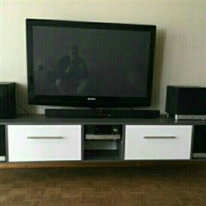 "42"" black Sansui TV with a Black JVC sound bar"