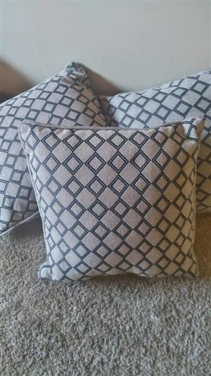 Beige and grey sequence couch cushions