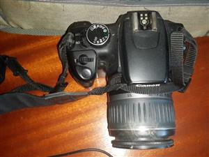 Canon Eos 350 D complete with underwater housing and bag and accessories including tripod ,strap