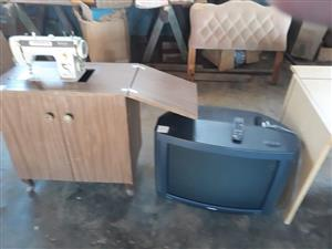 Tv and wooden sewing cabinet