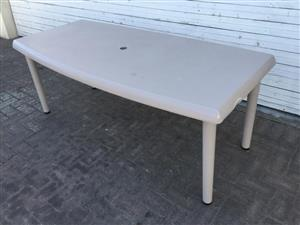 All purpose plastic table with removable feet & umbrella hole