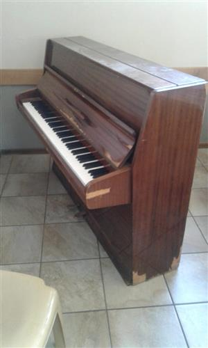 Piano in good working condition.Wooden case /rim needs attention