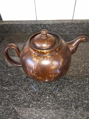 Dark brown stained teapot