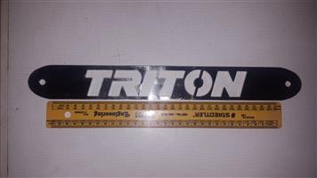 Triton cutout logo