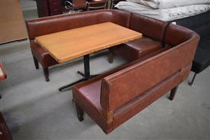 U Shaped brown leather bench with table
