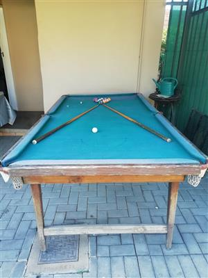 Pool table with balls and sticks for sale