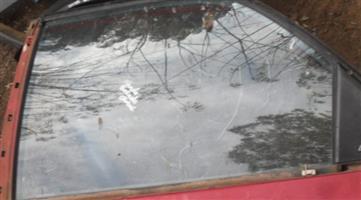 1996 honda ballade left rear door glass