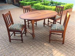 Antique 4 seater dining table and chairs