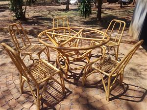 Cane furniture table and 5 chairs