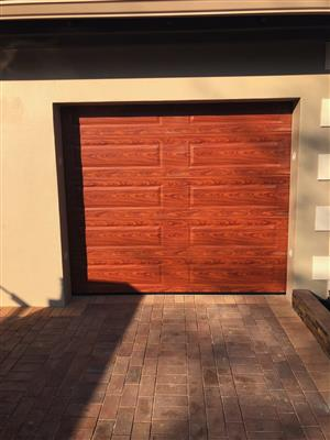 Single and double woodlook aluzinc sectional doors in Randburg