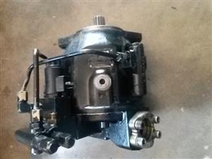 Komatsu WB97R-2 Hydraulic Pump for Sale. Reconditioned and Tested