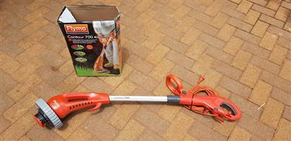 Flymo electric trimmer with all attachments