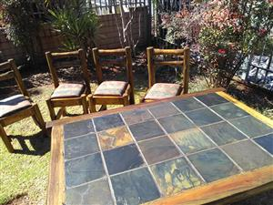 Beautiful slate top dining room table and four chairs for sale! (Ranch log furniture)