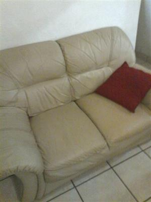 Beige 2 seater leather couch