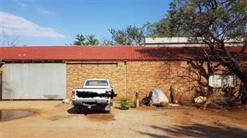 +/- 296m2 storage and 400m2 wide open space outside area to rent in kameeldrift East