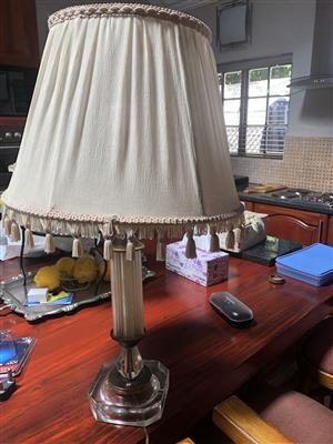 a beautifull brass floor standing lamp and a table lamp with white shade.