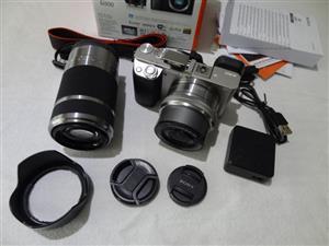 Sony Alpha a6000 24MP Mirrorless Camera 16-50mm & 55-210mm Zoom Lens