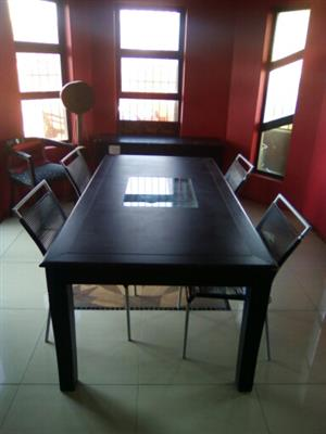 Dining room table with 4 chairs and side board for R4000 price negotiable