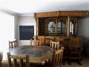 Home bar with table, chairs and rack for sale