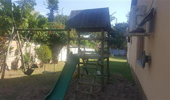 Jungle gym and swing chair for sale.