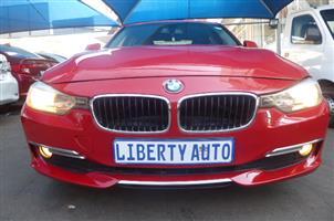 2012 BMW 3 Series 320i sports auto