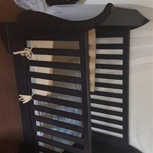 Sleigh cot and dresser